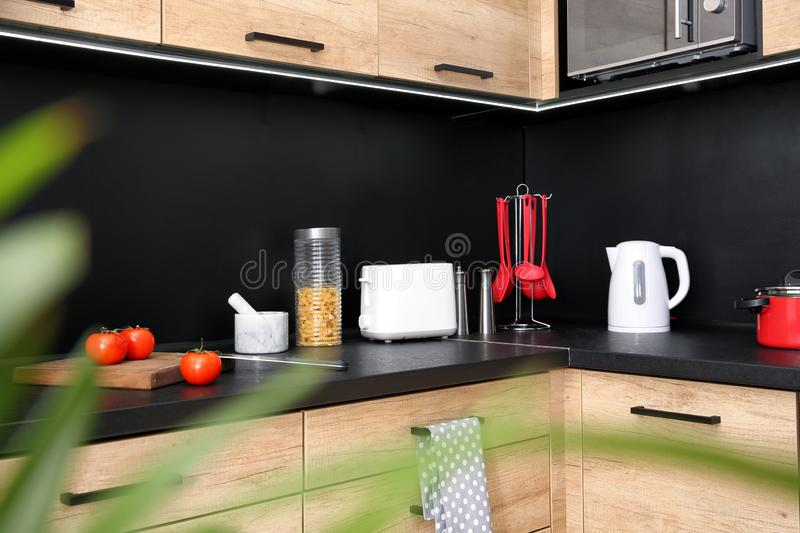 Kitchen interior with new furniture, appliances. And houseware stock photo