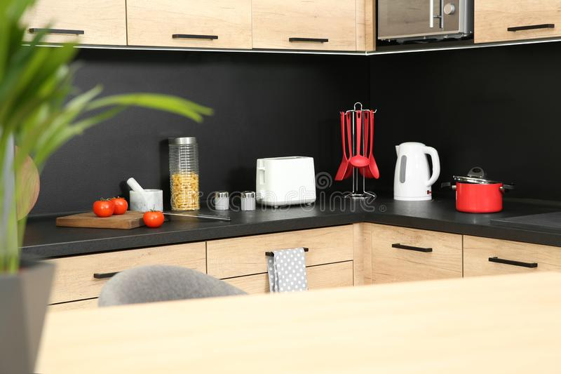 Kitchen interior with new furniture, appliances. And houseware stock image