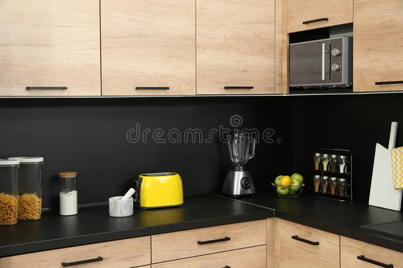 Kitchen interior with new furniture, appliances. And houseware royalty free stock image