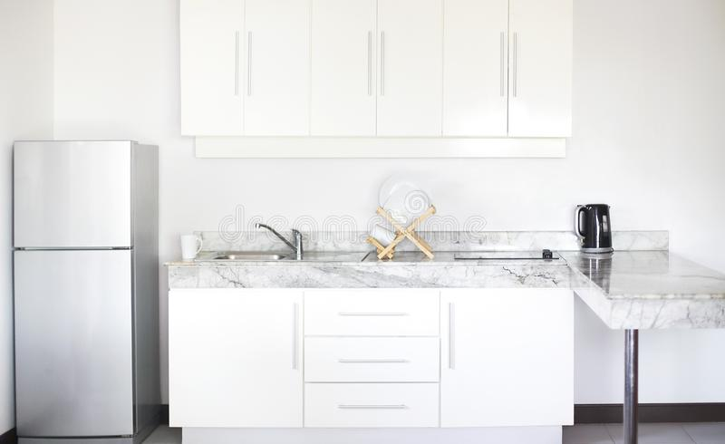 Kitchen interior in a new modern apartment in scandinavian style royalty free stock images