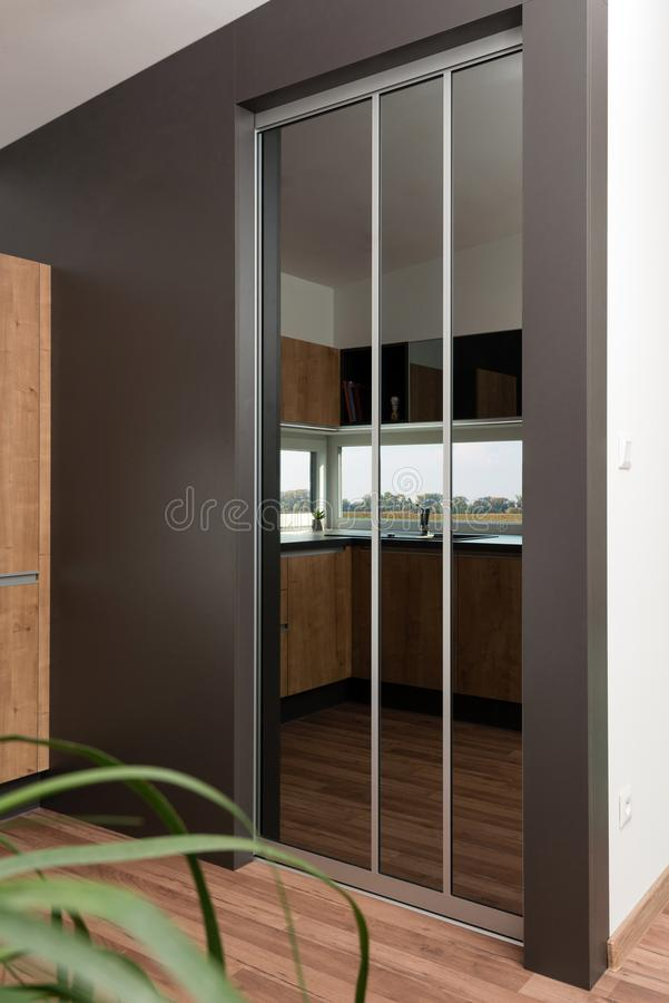 Kitchen interior. Sliding mirror door in contemporary kitchen interior stock images