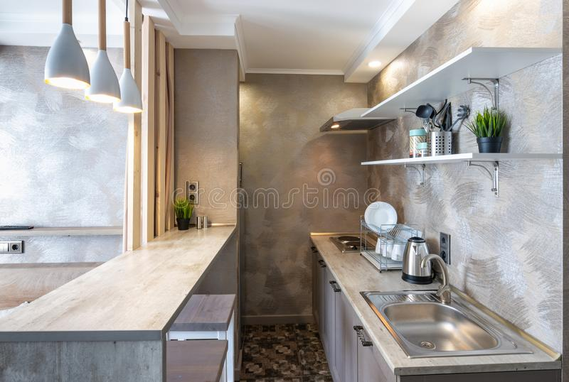 Kitchen interior in a small studio room stock images