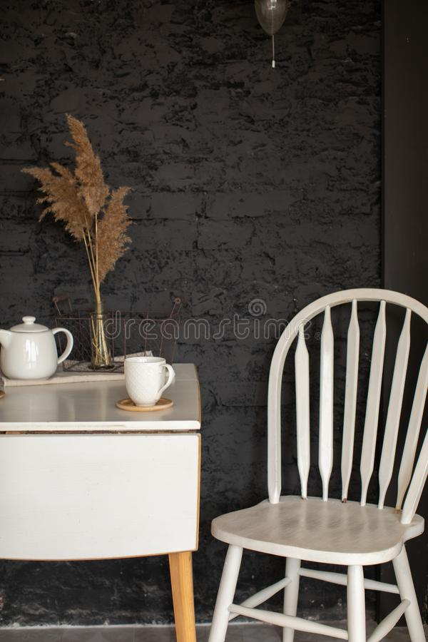 Kitchen interior with table and chair stock image