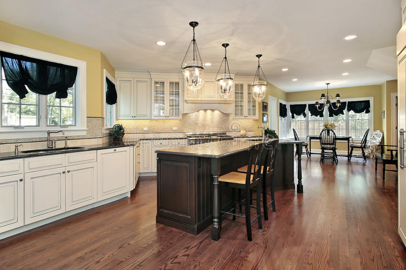 Kitchen With Island And Eating Area Stock Photo - Image of chair ...