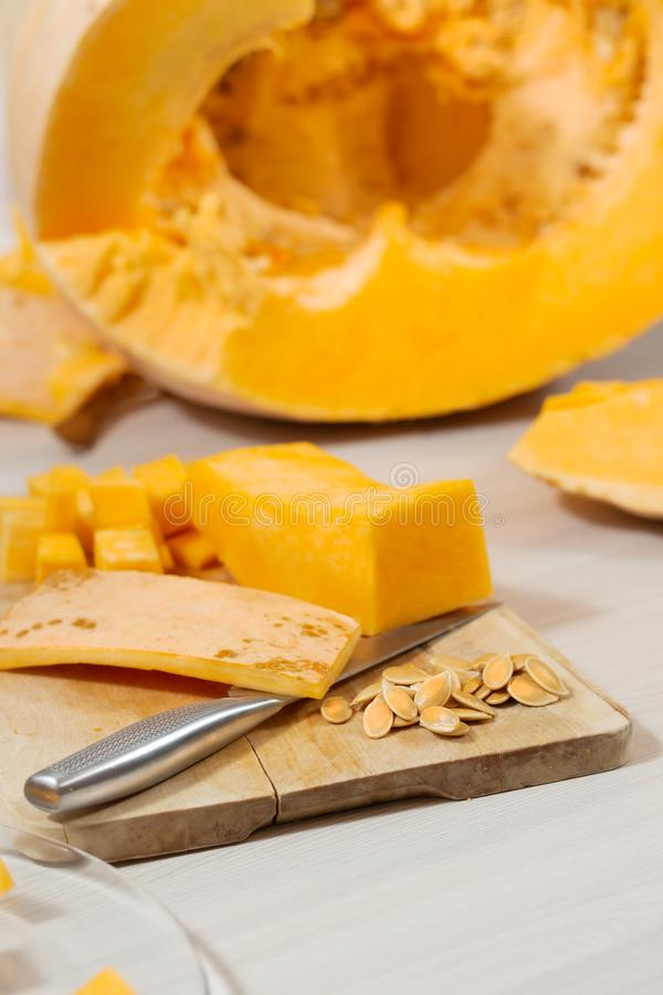 Half Cut Orange On Chopping Board With Knife Stock Image