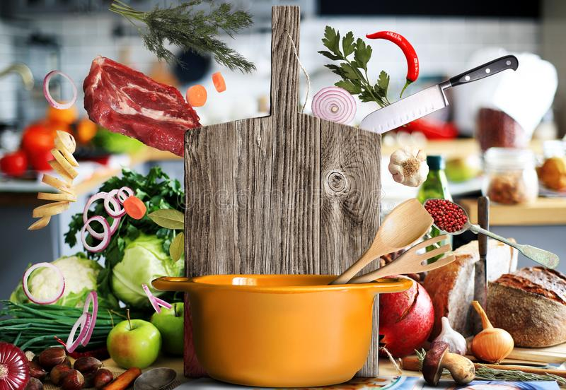 Kitchen a large wood board. With vegetables and bread stock image