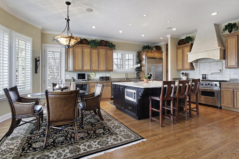Kitchen in luxury home. With large island stock images
