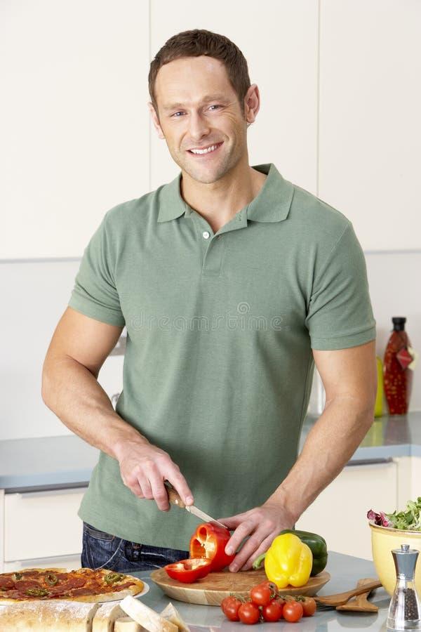 kitchen man meal preparing royaltyfri fotografi
