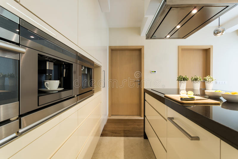Kitchen in a modern apartment stock photos