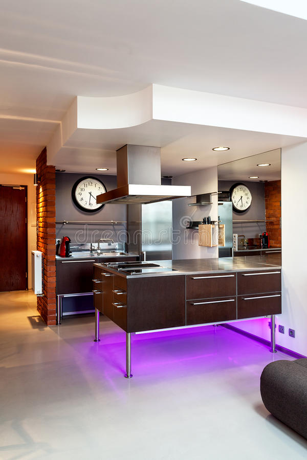 Kitchen. Modern kitchen interior with a brown furniture royalty free stock image