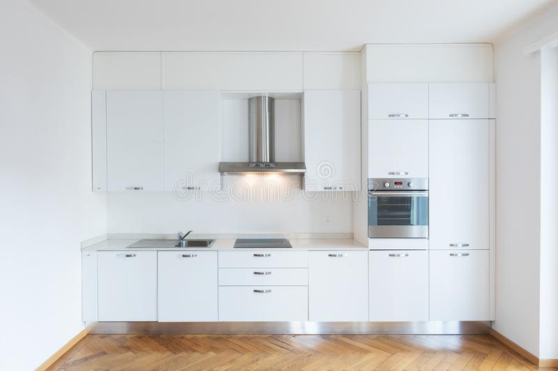 Kitchen in newly renovated open space with wooden floors stock photography