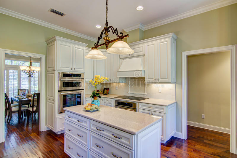 Kitchen. Open Kitchen with Island and white cabinets stock images