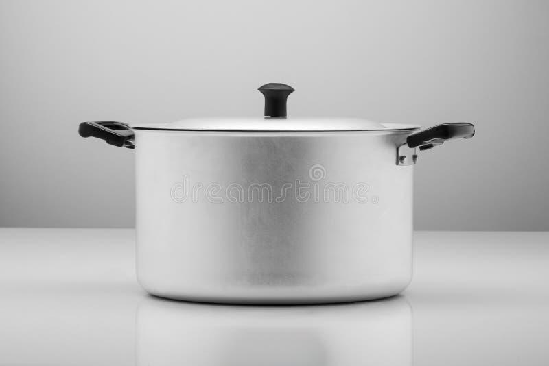 Kitchen pan on a light background stock image