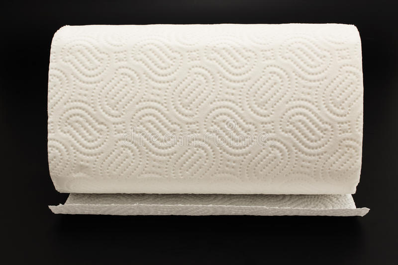 Kitchen Paper Towel on a Black Background royalty free stock photo