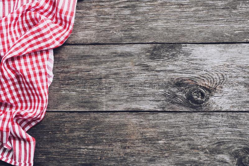 Kitchen plaid textile on old rustic wood. Food menu background stock images