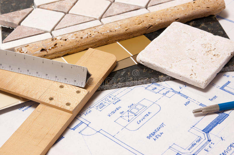 Kitchen remodel. Blueprints with drafting tools and stone samples for remodeling a kitchen