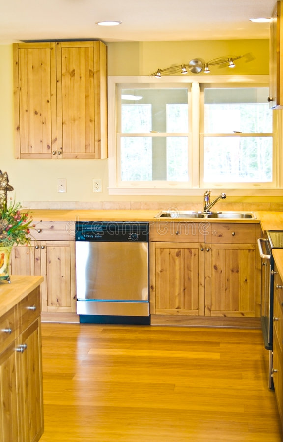 A Kitchen Remodel. A small kitchen that was remodeled, it has wooden counter tops and Bamboo flooring stock photography