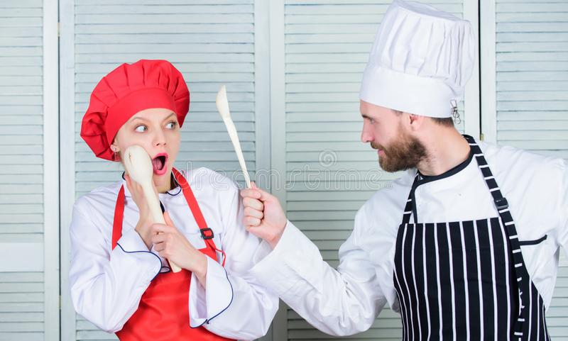 Kitchen rules. Culinary battle concept. Woman and bearded man culinary show competitors. Who cook better. Ultimate. Kitchen rules. Culinary battle concept. Woman royalty free stock photos