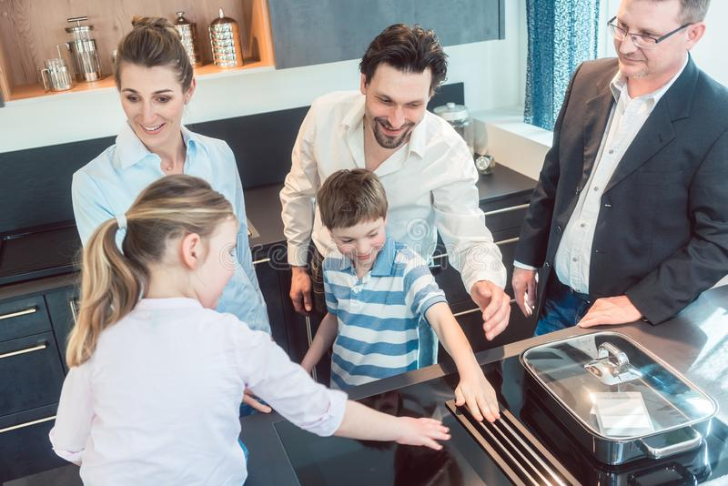 Kitchen sales with a family, kids, and a service expert royalty free stock image
