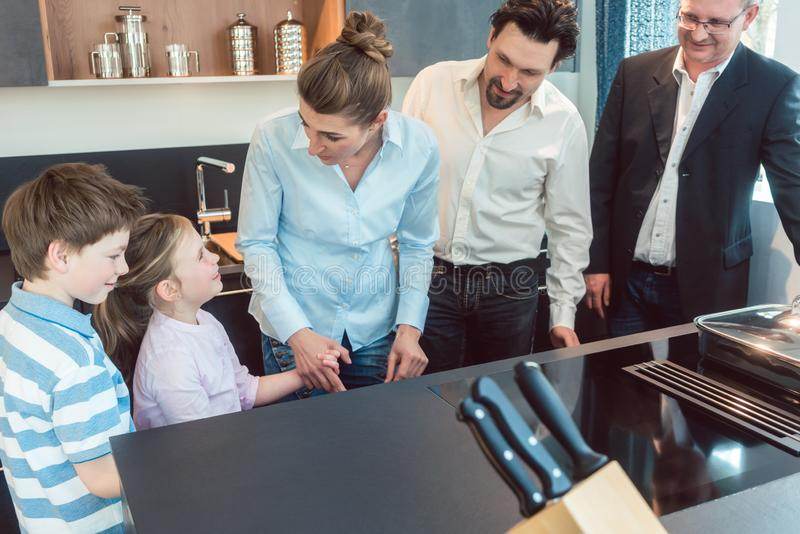 Kitchen sales with a family, kids, and a service expert stock photography
