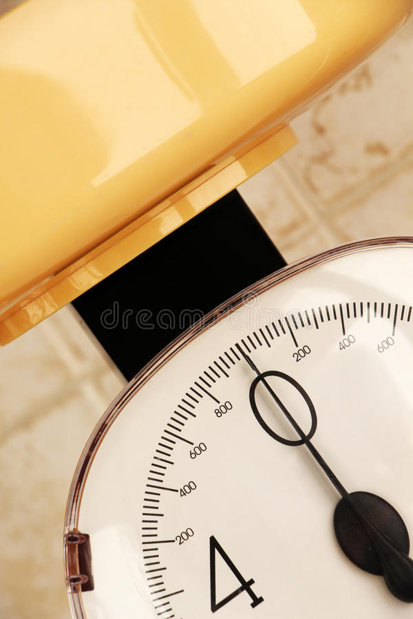 Kitchen scale, bright colours. Close-up view of a kitchen scale, perspective portrait cut royalty free stock image