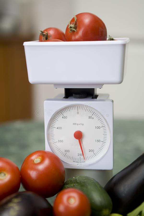 Kitchen scale and vegetables royalty free stock photo