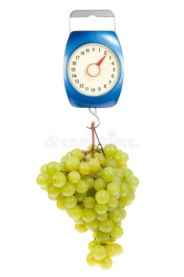 Kitchen scales and green grapes. stock photos