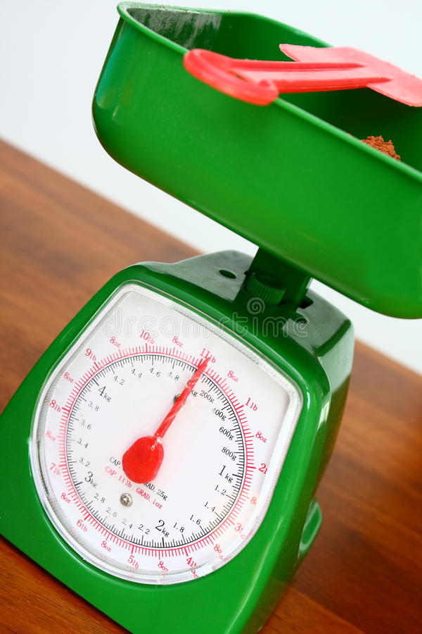 Kitchen scales weighing royalty free stock image