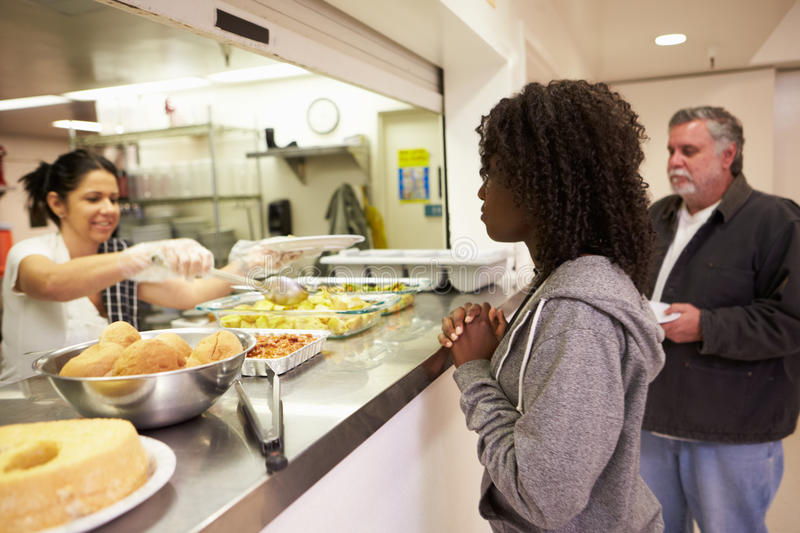 Kitchen Serving Food In Homeless Shelter. Horizontal Image Of Kitchen Serving Hot Food In Homeless Shelter stock photo