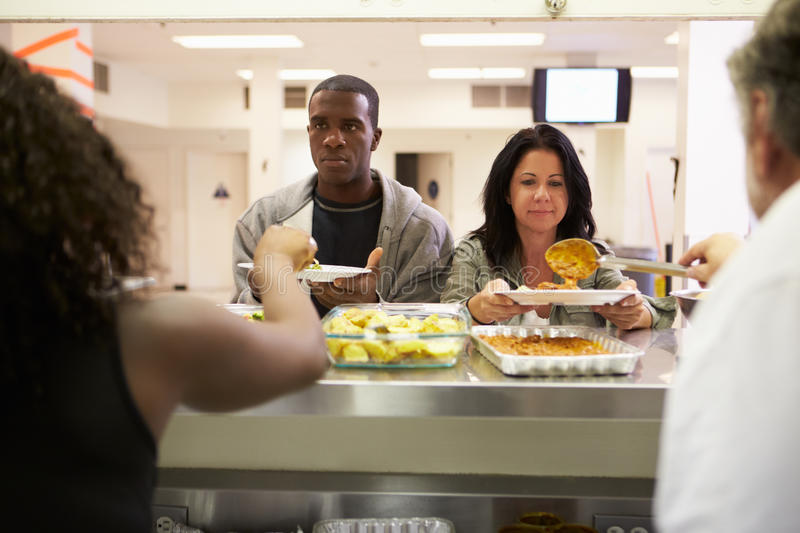 Kitchen Serving Food In Homeless Shelter. Kitchen Serving Hot Food In Homeless Shelter To Hungry Poor People stock photo