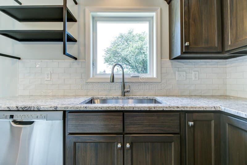 Kitchen sink with subway tile backspash. stock photography