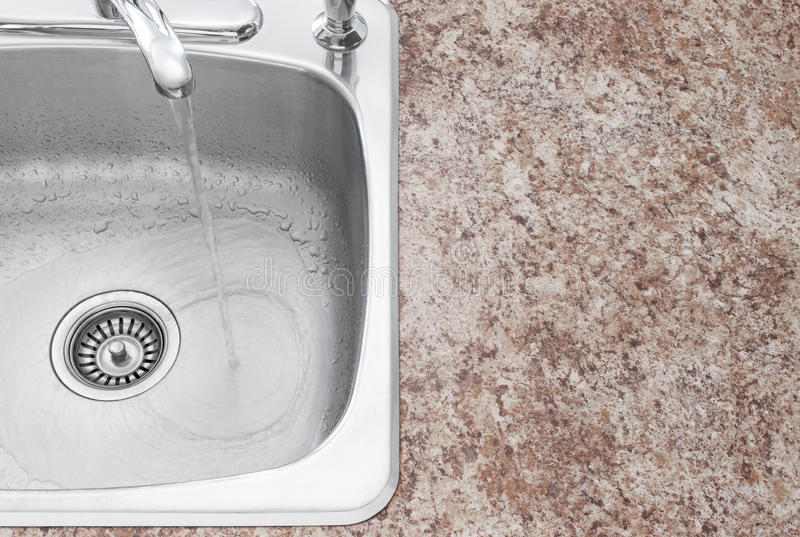 Kitchen sink, faucet and countertop detail stock image