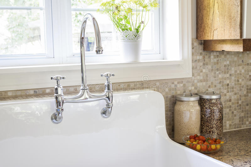 Kitchen sink and faucet royalty free stock photos