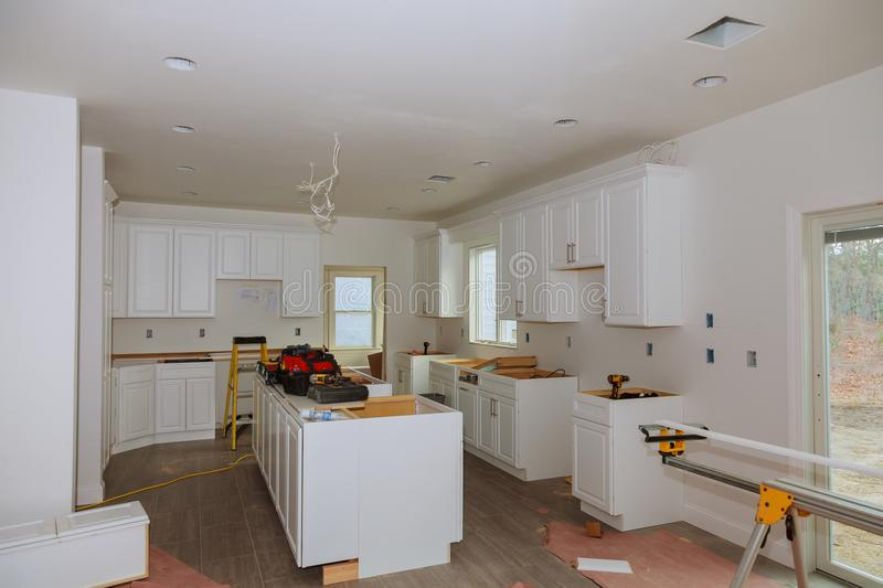 In the kitchen, the square is square-cut for installation. New construction royalty free stock images