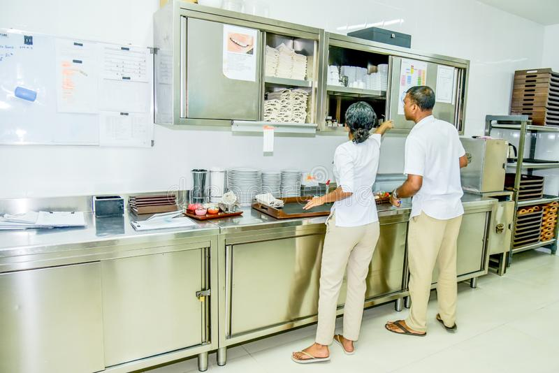 Kitchen staff team in uniform busy with their work royalty free stock photography