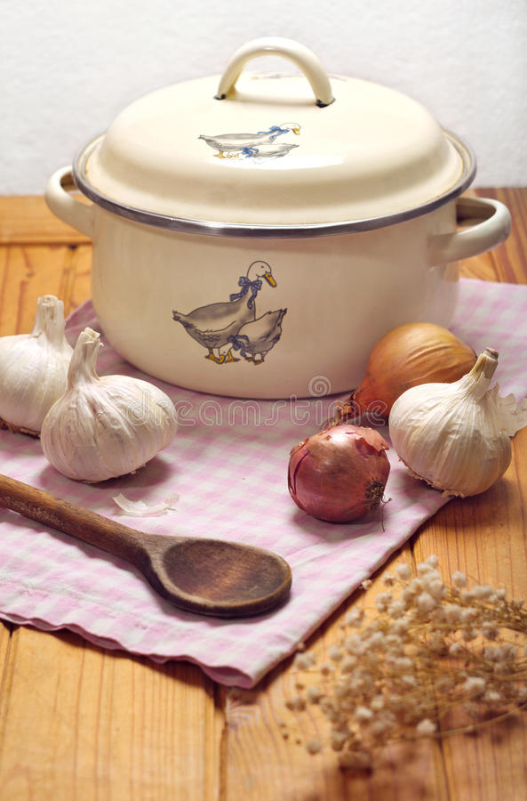 Kitchen still life. Country kitchen still life with pot and vegetables stock images