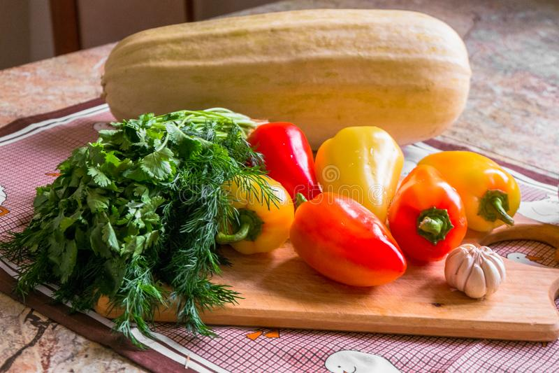 Kitchen still life. Fresh raw vegetables on the table. stock photos
