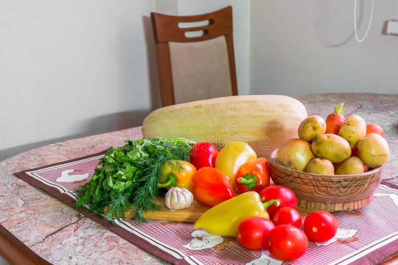 Kitchen still life. Fresh raw vegetables on the table. royalty free stock photography