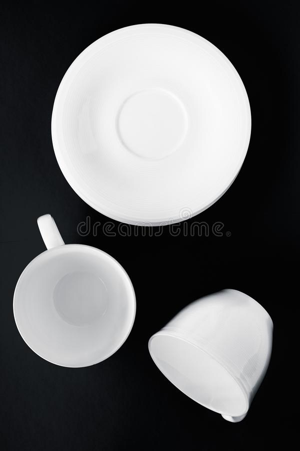 White tableware crockery set, empty cup on black flatlay background. Kitchen, table decor and drinks menu concept - White tableware crockery set, empty cup on stock image