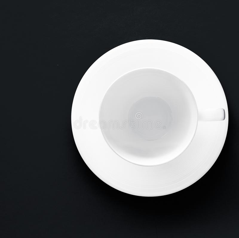White tableware crockery set, empty cup on black flatlay background. Kitchen, table decor and drinks menu concept - White tableware crockery set, empty cup on stock photos