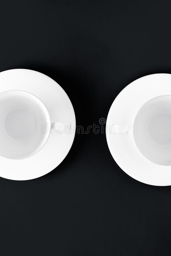 White tableware crockery set, empty cup on black flatlay background royalty free stock images