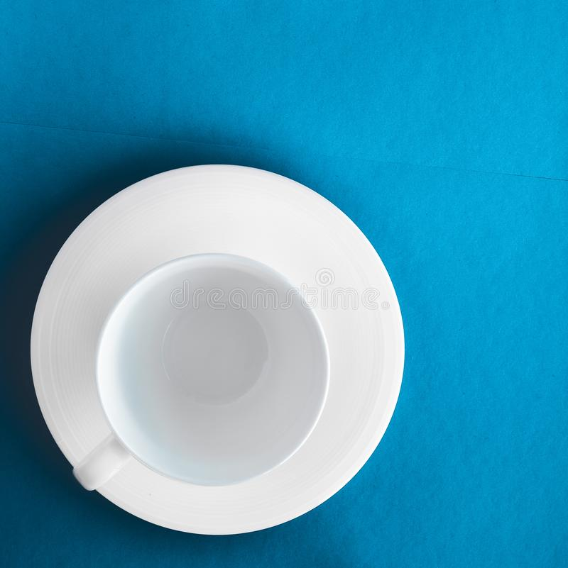 White tableware crockery set, empty cup on blue flatlay background royalty free stock images