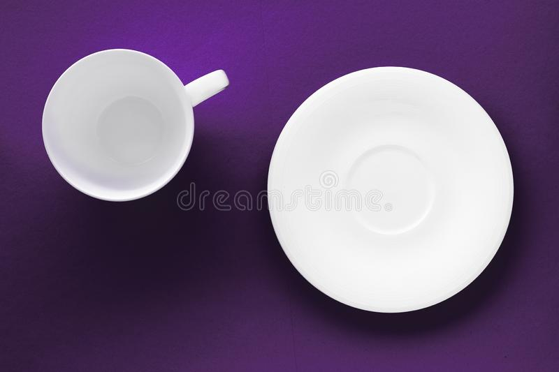 White tableware crockery set, empty cup on purple flatlay background. Kitchen, table decor and drinks menu concept - White tableware crockery set, empty cup on stock images