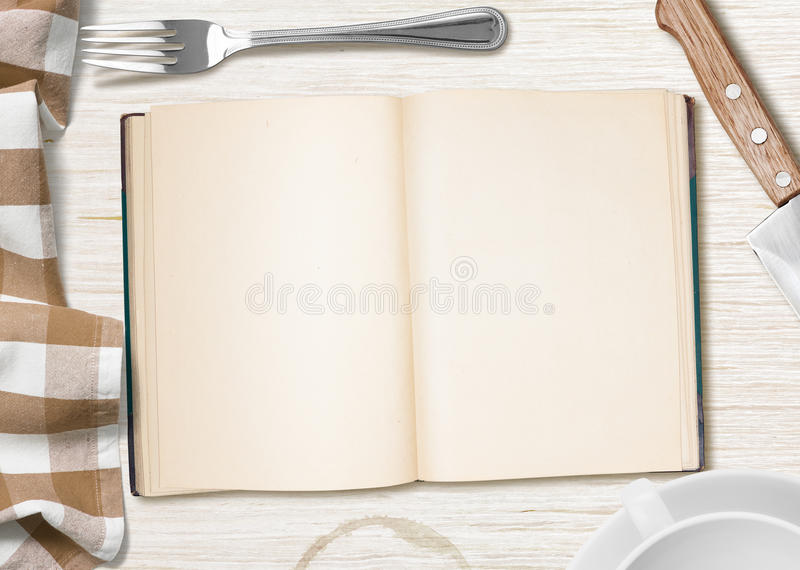 Kitchen table with open book or copybook for cooking recipe. Kitchen table with open book or copybook as a background for cooking recipe stock image