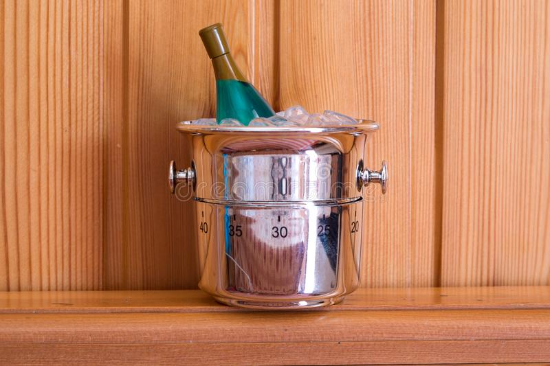 Kitchen timer shaped like champagne bottle on a wood background stock images