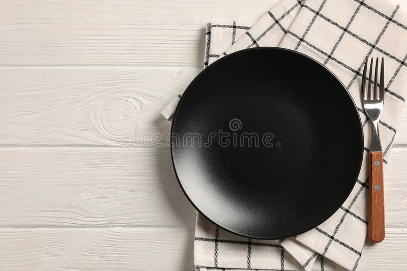 Kitchen towel with cutlery on wooden background royalty free stock photos