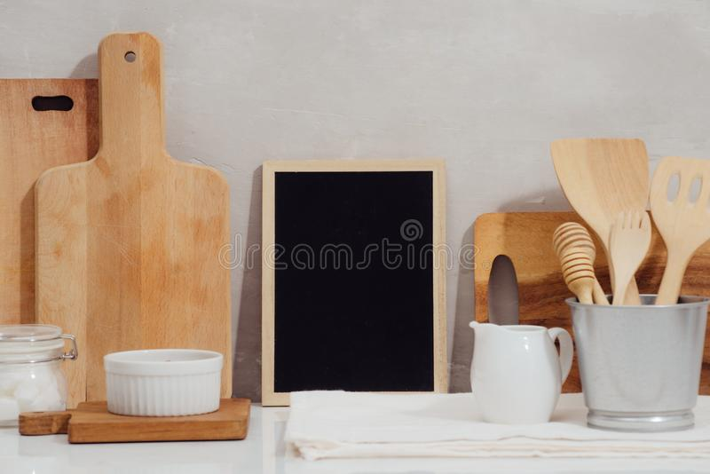 Kitchen utensils background with a blank space for a text, home kitchen decor concept, front view.  royalty free stock photos