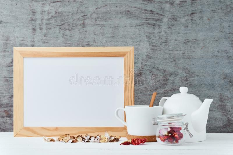 Kitchen utensils background with empty white paper, teapot, cup and a honey in glass jar, kitchen mock up with copy space royalty free stock images