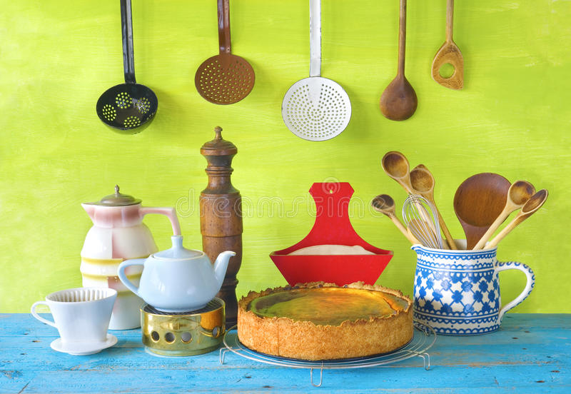 Kitchen utensils and a cheese cake, cooking concept stock photography