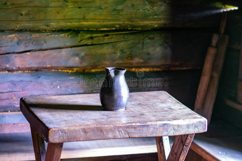 Kitchen utensils in the interior of old traditional rural wooden house. royalty free stock photo